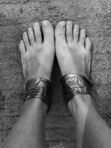 Feet after - duct taped, blisters, and oh-so-smelly! :P